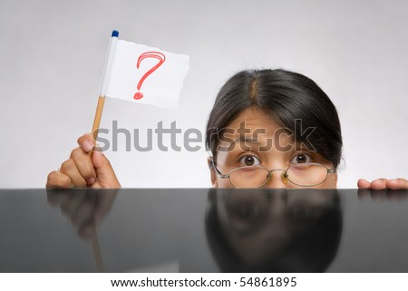 Woman holding question mark flag made of paper and pencil - stock photo