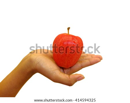 Woman holding red apple in the palm of her hand.