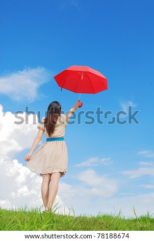 Woman holding red umbrella and cloud sky
