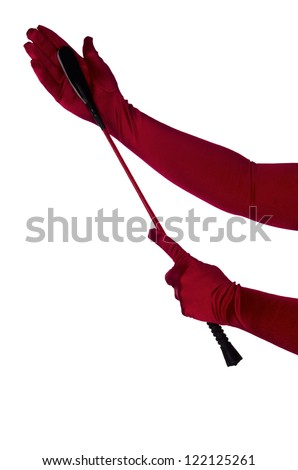 Woman holding riding crop, ready to give a spank. Close up. - stock photo