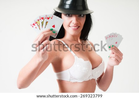 Woman holding Royal Flush for fortune to gamblers - stock photo
