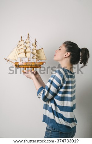 Woman holding ship