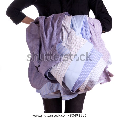 Woman holding shirt in hand isolated