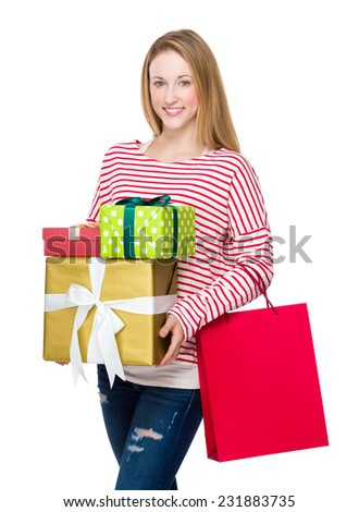 Woman holding shopping bag and present box - stock photo