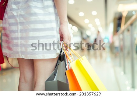 Woman holding shopping bags - stock photo