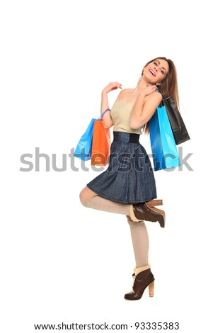 woman holding shopping bags against white background - stock photo