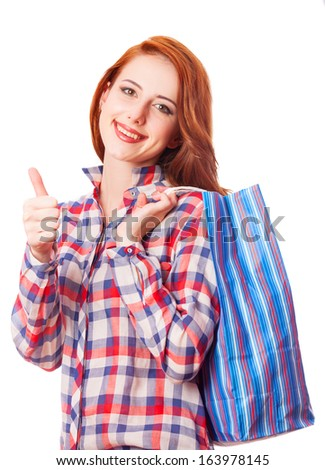 woman holding shopping bags and smiling