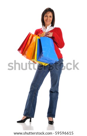 Woman holding shopping bags isolated on a white background