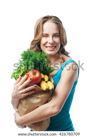 woman holding shopping bags, look at the camera