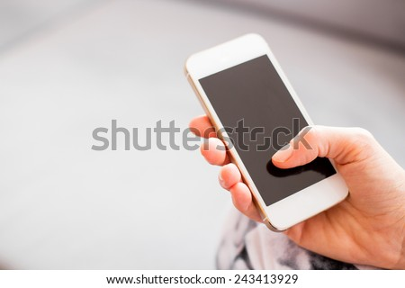 Woman holding smartphone - stock photo