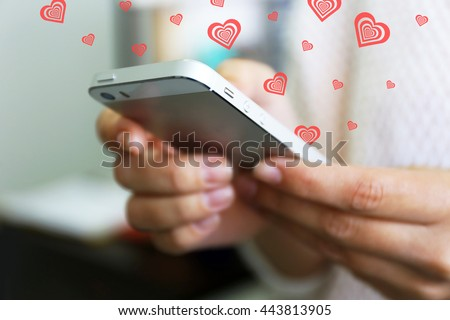 Woman holding smartphone indoors