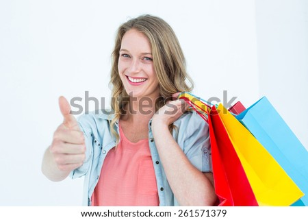 Woman holding some shopping bags on white background - stock photo