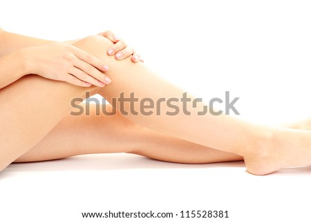 woman holding sore knee, isolated on white - stock photo