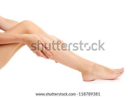 woman holding sore leg, isolated on white
