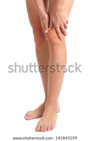 woman holding sore leg, isolated on white - stock photo