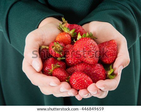 Woman holding strawberry on open palms
