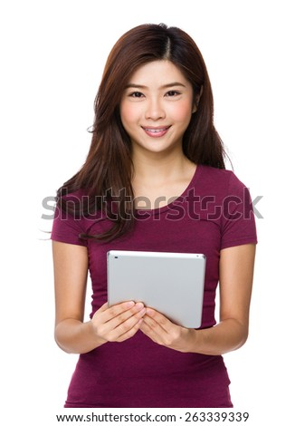 Woman holding tablet compute - stock photo