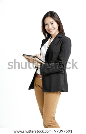 Woman holding tablet computer isolated on white background. - stock photo