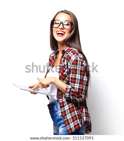 Woman holding tablet computer isolated on white background. working on touching screen. Casual smiling caucasian woman. - stock photo