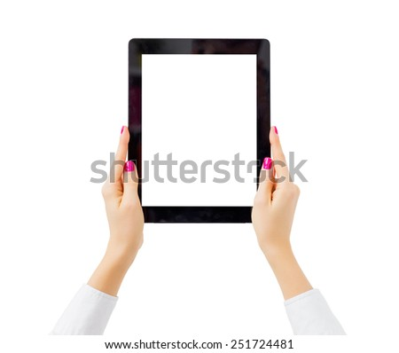 Woman holding tablet computer vertically - stock photo