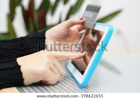 Woman holding tablet pc and credit card , Internet Shopping Concept - stock photo