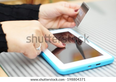 Woman holding tablet pc and credit card , on line Shopping Concept - stock photo