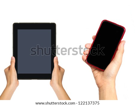 Woman holding  tablet with mobile phone; Isolated on white - stock photo
