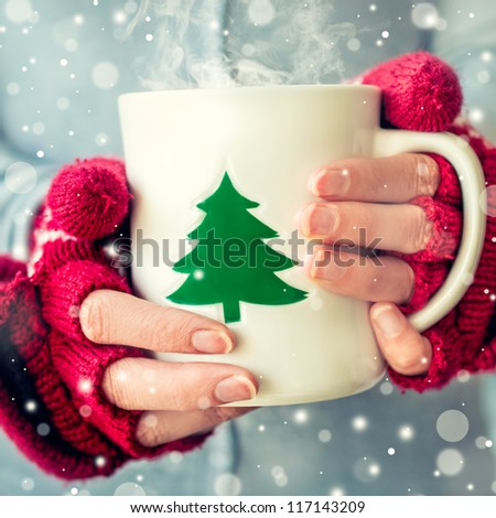 Woman holding tea cup. - stock photo