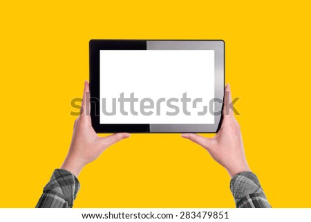 Woman Holding Ten Inch Digital Tablet Computer in Horizontal Position with Blank White Screen as Copy Space over Solid Yellow Background - stock photo