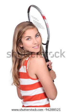 Woman holding tennis racket - stock photo