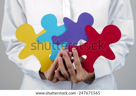 woman holding the multicolor of human paper cut-out