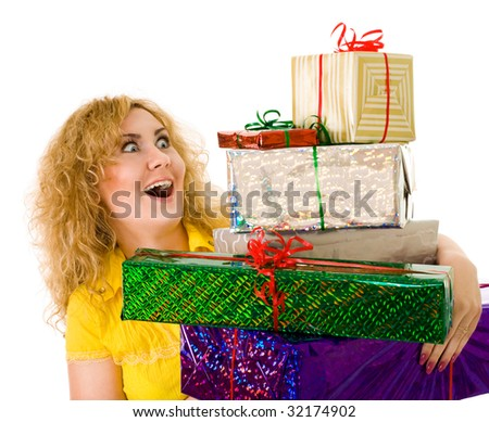 woman holding ton's of presents
