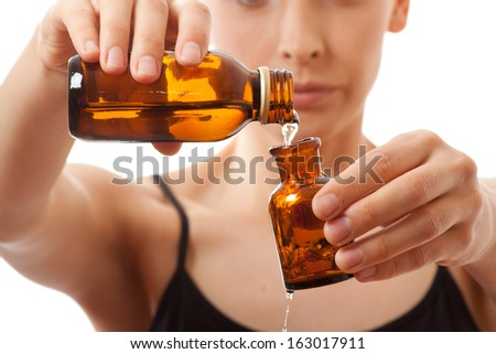 woman holding  two bottles of medicine, isolated on white background