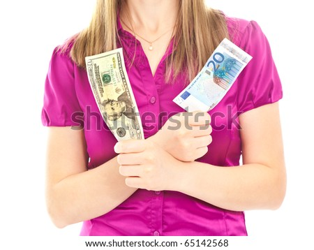 Woman holding two different banknotes