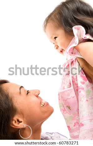 Woman holding up a baby in her arms . - stock photo
