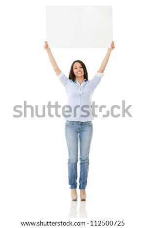 Woman holding up a banner - isolated over white background - stock photo