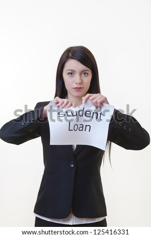 woman holding up a piece of paper with the words student loan written on it and tearing the sheet of paper in half - stock photo