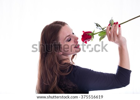 Woman Holding up Rose