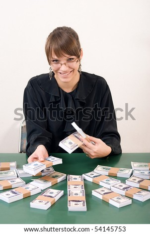 Woman holding US money, dollars with smile on her face