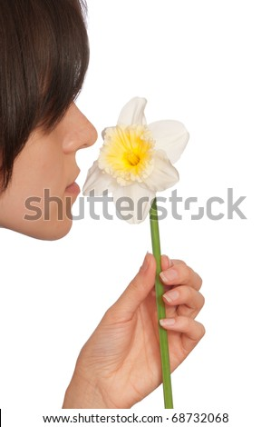 woman holding white narcissus in the hand - stock photo