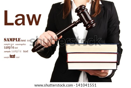 Woman holding wooden gavel and law books isolated on white