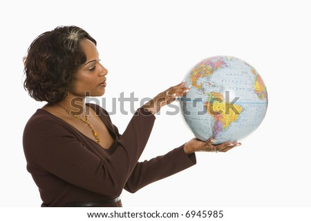 Woman holding world globe out between hands.
