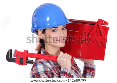 Woman holding wrench and tool box - stock photo