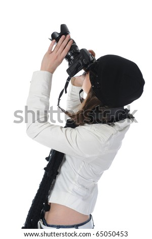 woman holds a camera - stock photo