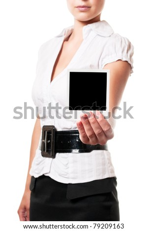 Woman holds a instant photo. Focus on instant photo. - stock photo
