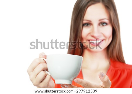 woman holds coffee cup isolated close up portrait woman is out of focus, cup is on focus ready for your text