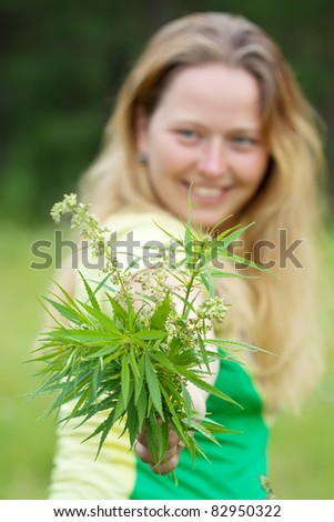 Woman holds fresh cannabis bouquet - stock photo