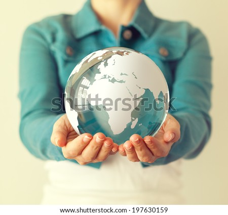 Woman holds glass earth in her hands. Globe - stock photo