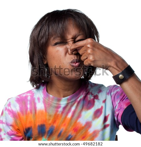 Woman holds her nose for a bad smell - stock photo