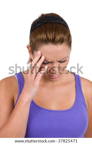 Woman holds her temple and shutters in a stressful situation. - stock photo